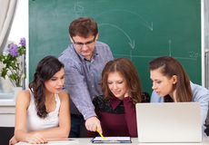 Teacher and students. Teacher in training class with students Stock Images