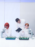Teacher supervising lab experiments Stock Image