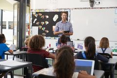 Teacher with tablet in front of elementary school class Royalty Free Stock Photo