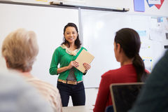 Teacher with tablet and students at an adult education class Royalty Free Stock Image