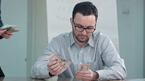 Teacher taking money and counting dollar bills. Close up. Professional shot in 4K resolution. 075. You can use it e.g. in your commercial video, business stock video footage