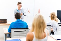 Teacher talking with students Stock Photography