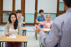 Teacher talking to the class Royalty Free Stock Photos