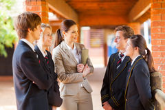 Teacher talking to students Stock Image