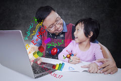 Teacher talks with his student in class Stock Images