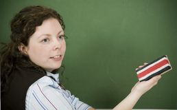 Teacher Teacher. Young teacher in front of a chalkboard stock photography