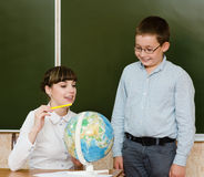 Teacher teaches boy showing Globe Royalty Free Stock Photos