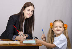 The teacher teaches lessons with a student sitting at the table Stock Photos