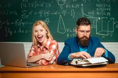 Teacher teaches a student. Students campus education knowledge concept. School day. Students preparing for university. Exams. Concept of education and teaching royalty free stock image