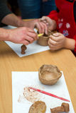 The teacher teaches the student to sculpt with clay. Stock Photography