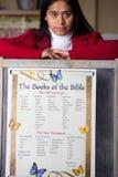 Hispanic Home School Teacher with Bible Chart Stock Photo
