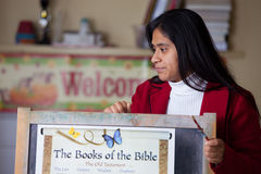 Hispanic Home School Teacher with Bible Chart Royalty Free Stock Image