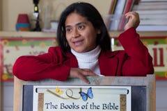 Hispanic Home School Teacher with Bible Chart Stock Image
