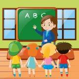 Teacher teaching in classroom Royalty Free Stock Photos