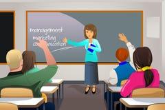 Teacher teaching college student Stock Image