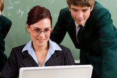 Teacher teaching computer Stock Photo