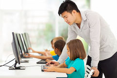 Teacher teaching computer Stock Images