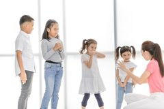 Teacher teaching kids in acting class. stock photography