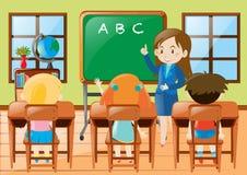 Teacher teaching kindergarten students in class Stock Images