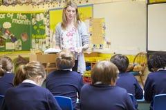 Teacher Teaching Lesson To Elementary School Pupils Royalty Free Stock Photos
