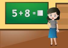 Teacher teaching math in classroom Stock Image