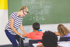 Teacher teaching mathematics to school kids in classroom Stock Photos