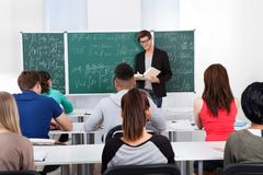 Teacher Teaching Mathematics To Students Royalty Free Stock Image