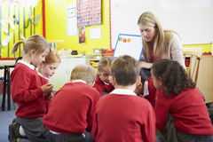 Teacher Teaching Spelling To Elementary School Pupils Stock Photo