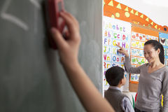 Teacher teaching student the alphabet Royalty Free Stock Image