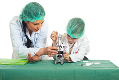 Teacher teaching student in laboratory Royalty Free Stock Photos