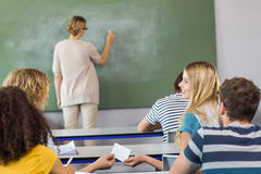 Teacher teaching students in class Stock Images