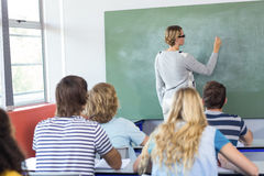 Teacher teaching students in class Stock Photos
