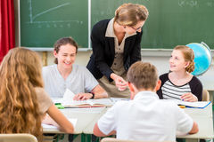 Teacher teaching students  geography lessons in school Stock Photos