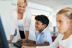 Young boy using computer Stock Photography