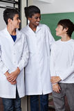Teacher And Teenage Boys Standing Together Royalty Free Stock Photo