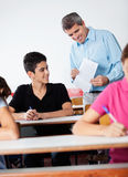 Teacher And Teenage Schoolboy Looking At Paper Royalty Free Stock Images
