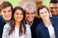 Teacher teenage students. Close up portrait of cheerful high school teacher and teenage students Stock Image