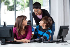 Teacher And Teenage Students In Computer Lab Stock Image