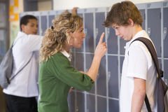 A teacher telling a student off Royalty Free Stock Image