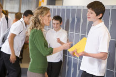 A teacher telling a student off royalty free stock images