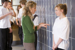 A teacher telling a student off stock photography