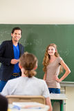 Teacher testing  student  in math lessons in school class Stock Photography