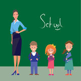 Teacher and three students of primary grades. On a green background with the inscription SCHOOL Stock Images