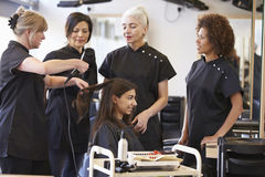Teacher Training Mature Students In Hairdressing Stock Images
