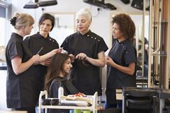 Teacher Training Mature Students In Hairdressing royalty free stock image