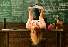 Teacher or tutor helps preschool child, High school college students studying and reading together in class education. Concepts, Teacher collaborates with stock image