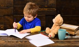 Teacher or tutor helps preschool child. Teachers reputation is gold. Teacher creates sense of community and belonging in royalty free stock images