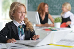 Teacher with two girls at lesson Stock Photo