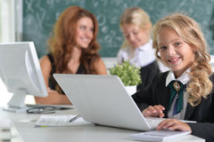 Teacher with two girls at lesson Royalty Free Stock Photo