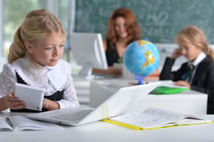 Teacher with two girls at lesson Stock Photography